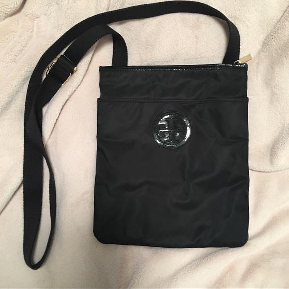 4c25cf41bd684 Nylon Ella Swingpack Crossbody. M 5a39adaa9d20f0f42a022dc6. Other Bags you  may like. Brand new Tory Burch ...